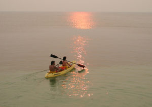 Take a kayaking trip at sunset, full moon or at late night